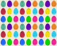 Άνευ ραφής σχέδιο με τα αυγά Πάσχας με τα πρόσωπα χαμόγελου Στοκ Εικόνα