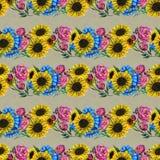 Άνευ ραφής σχέδιο με τα μπλε κίτρινα και ρόδινα λουλούδια Στοκ εικόνες με δικαίωμα ελεύθερης χρήσης