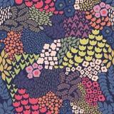 Άνευ ραφής σχέδιο με τα λουλούδια σε ένα μπλε υπόβαθρο Στοκ Φωτογραφίες