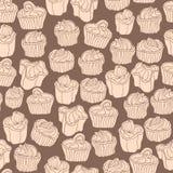 Άνευ ραφής σχέδιο με τα cupcakes στο εκλεκτής ποιότητας ύφος doodle στο καφετί υπόβαθρο Στοκ φωτογραφία με δικαίωμα ελεύθερης χρήσης