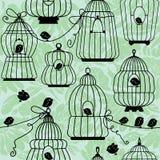 Άνευ ραφής σχέδιο με τις διακοσμητικές σκιαγραφίες κλουβιών πουλιών Στοκ Εικόνες