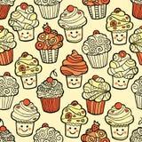 Άνευ ραφής σχέδιο με το χαριτωμένο χαμόγελο cupcakes στο θερμό υπόβαθρο Απεικόνιση αποθεμάτων