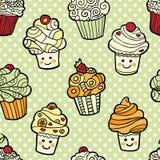 Άνευ ραφής σχέδιο με το χαριτωμένο χαμόγελο cupcakes στο πράσινο διαστιγμένο υπόβαθρο Ελεύθερη απεικόνιση δικαιώματος