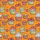 Άνευ ραφής σχέδιο με muffins και τα κεράσια Στοκ Εικόνα