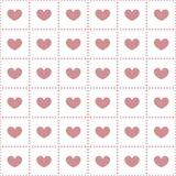 Άνευ ραφής σχέδιο των καρδιών στα κύτταρα Στοκ φωτογραφία με δικαίωμα ελεύθερης χρήσης