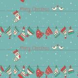 Άνευ ραφής σχέδιο Χριστουγέννων με τα πουλιά, τις κάλτσες και το χ Στοκ Φωτογραφία
