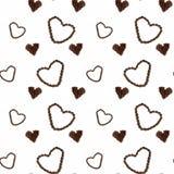 Άνευ ραφής υπόβαθρο καφέ με τα φασόλια καφέ στη μορφή καρδιών Στοκ Εικόνες