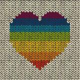 Άνευ ραφής υπόβαθρο με πλεκτή την ουράνιο τόξο καρδιά Στοκ Εικόνες