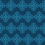 Άνευ ραφής υπόβαθρο με την μπλε διακόσμηση στο σκοτεινό υπόβαθρο Στοκ φωτογραφίες με δικαίωμα ελεύθερης χρήσης