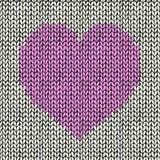 Άνευ ραφής υπόβαθρο με τη ρόδινη πλεκτή καρδιά Στοκ φωτογραφίες με δικαίωμα ελεύθερης χρήσης