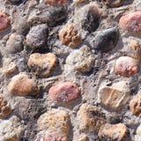 Άνευ ραφής υπόβαθρο της παλαιάς φωτογραφίας σύστασης τοίχων πετρών Ζωηρόχρωμος παλαιός τοίχος πετρών Στοκ Φωτογραφίες