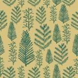 Άνευ ραφής χριστουγεννιάτικο δέντρο σχεδίων στο χρυσό υπόβαθρο Στοκ Εικόνες