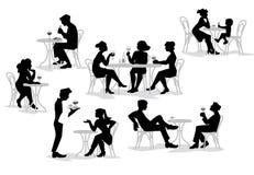 Άνθρωποι, άνδρες και γυναίκες που κάθονται στο café Απεικόνιση αποθεμάτων