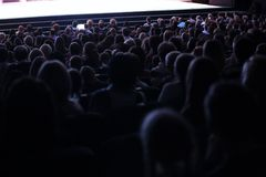 Άνθρωποι που κάθονται σε ένα ακροατήριο Στοκ Φωτογραφία