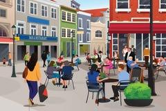 Άνθρωποι που κάθονται στον υπαίθριο καφέ Στοκ εικόνα με δικαίωμα ελεύθερης χρήσης
