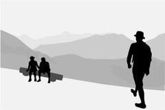Άνθρωποι που περπατούν μέσω των βουνών Στοκ εικόνα με δικαίωμα ελεύθερης χρήσης