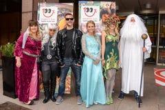 Άνθρωποι που το φανταχτερό κοστούμι φορεμάτων Στοκ Εικόνες