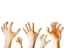 άνθρωπος χεριών που ανατρέ& Στοκ Εικόνα