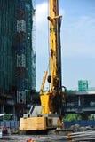 Άντεξε την εγκατάσταση γεώτρησης σωρών στο εργοτάξιο οικοδομής Στοκ φωτογραφίες με δικαίωμα ελεύθερης χρήσης
