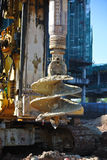Άντεξε το τρυπάνι εγκαταστάσεων γεώτρησης σωρών στο εργοτάξιο οικοδομής Στοκ Εικόνα