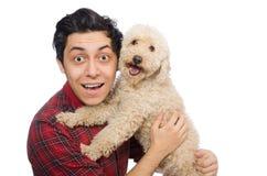 Άνδρας με το σκυλί που απομονώνεται νεαρός στο λευκό Στοκ Εικόνες