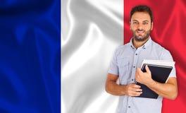Άνδρας σπουδαστής πέρα από τη γαλλική σημαία Στοκ φωτογραφία με δικαίωμα ελεύθερης χρήσης