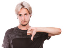 Άνδρας σπουδαστής που δίνει τον αντίχειρα κάτω Στοκ Φωτογραφίες