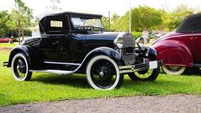 Άποψη δεξιά πλευρών της μαύρης horseless μεταφοράς της Ford του 1928 Στοκ εικόνες με δικαίωμα ελεύθερης χρήσης