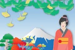 Άποψη του υποστηρίγματος Φούτζι και του ζωηρόχρωμου δέντρου με το ιαπωνικό κορίτσι απεικόνιση αποθεμάτων