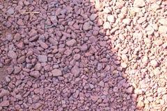 Άποψη των μικρών πετρών στο έδαφος, υπόβαθρο πετρών, υπόβαθρο χαλικιών, συστάσεις χαλικιών Στοκ εικόνες με δικαίωμα ελεύθερης χρήσης