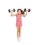 Άποψη υψηλού σημείου του κοριτσιού που βρίσκεται στο πάτωμα και που κάνει την άσκηση με το δ Στοκ εικόνα με δικαίωμα ελεύθερης χρήσης