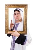 Άραβας με το πλαίσιο εικόνων Στοκ Εικόνες