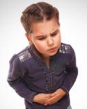 Άρρωστοι λίγος πόνος κοριτσιών παιδιών στο στομάχι, κοιλιά Στοκ Φωτογραφίες