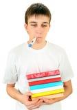 Άρρωστος σπουδαστής με βιβλία Στοκ εικόνα με δικαίωμα ελεύθερης χρήσης