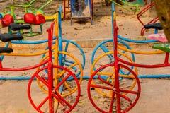 Άσκηση παιδικών χαρών του ζωηρόχρωμου ποδηλάτου Στοκ εικόνες με δικαίωμα ελεύθερης χρήσης