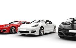 Άσπρα κόκκινα και μαύρα αυτοκίνητα Στοκ Εικόνες