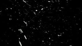 Άσπρα μόρια σε μια μαύρη μύγα υποβάθρου από την κορυφή στο αριστερό απεικόνιση αποθεμάτων