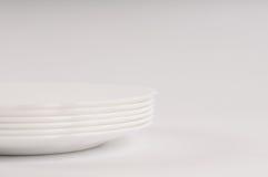 Άσπρα πιάτα αεροπλάνων στο άσπρο υπόβαθρο Στοκ εικόνα με δικαίωμα ελεύθερης χρήσης