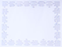 Άσπρα σύνορα κομματιού γρίφων Στοκ εικόνα με δικαίωμα ελεύθερης χρήσης