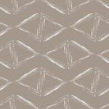 Άσπρα τρίγωνα σε ένα μπεζ υπόβαθρο Στοκ Εικόνες