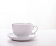 Άσπρα φλυτζάνι και πιατάκι Στοκ Φωτογραφίες