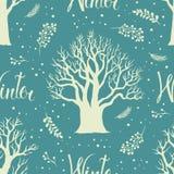 Άσπρα χειμερινά δέντρα σε ένα μπλε υπόβαθρο Στοκ Φωτογραφίες