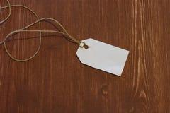 Άσπρη κενή ξύλινη σύσταση ετικεττών con Στοκ Φωτογραφίες
