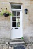Άσπρη μπροστινή πόρτα στοκ φωτογραφία
