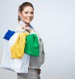 Άσπρη τσάντα αγορών λαβής επιχειρησιακών γυναικών που γυρίζουν πίσω Στοκ εικόνες με δικαίωμα ελεύθερης χρήσης