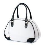 Άσπρη τσάντα με τις μαύρες λαβές που απομονώνονται στο άσπρο υπόβαθρο Στοκ φωτογραφία με δικαίωμα ελεύθερης χρήσης