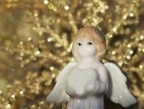 Άσπρος αριθμός αγγέλου για το ελαφρύ υπόβαθρο Χριστουγέννων στοκ εικόνες