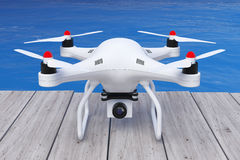 Άσπρος κηφήνας Quadrocopter με τη κάμερα φωτογραφιών μπροστά από τον ωκεανό τρισδιάστατος Στοκ Εικόνες