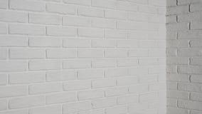 Άσπρος τουβλότοιχος με τη γωνία ως υπόβαθρο φιλμ μικρού μήκους