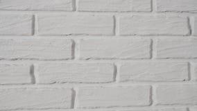 Άσπρος τουβλότοιχος ως υπόβαθρο φιλμ μικρού μήκους